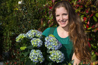 woman posing with hydrangea flower