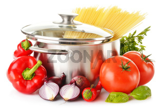 Stainless pot with spaghetti and variety of raw vegetables