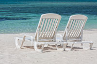 Sun loungers facing the Caribbean Sea