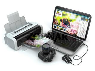 Laptop, photo camera and printer. Preparing images for print.