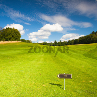 Empty golf fairway in sunny day