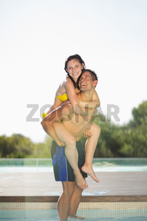 Gorgeous couple having fun poolside on holidays
