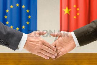 Representatives of the EU and China shake hands