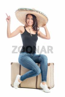 frau mit sombrero und koffer