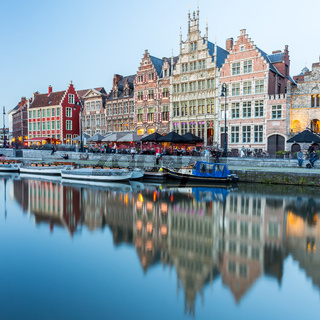 Picturesque medieval buildings overlooking the 'Graslei harbor' on Leie river in Ghent town, Belgium, Europe.
