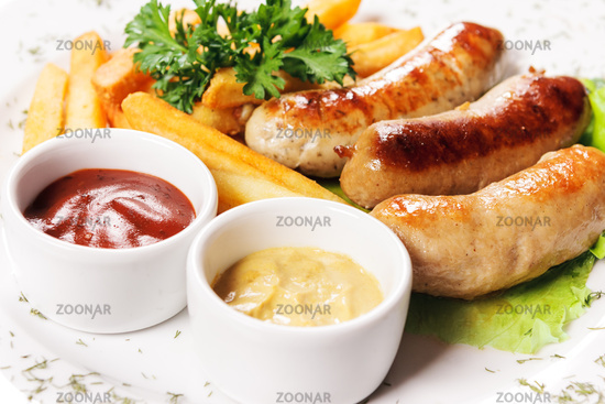Tasty meat sausages with vegetables