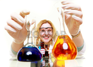 chemist woman or girl student or female laboratory assistant or scientific researcher with chemical glassware test flask. Experiment