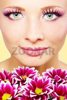 Beutiful girl face with chrysanthemum