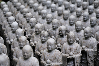 rows of similar japanese jizo sculptures in Hase-Dera temple