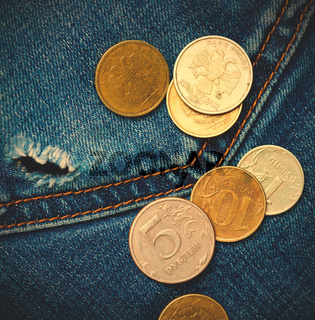 jeans pocket with hole and coins