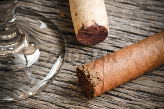 Cigar with Glass of wine on Wooden Background