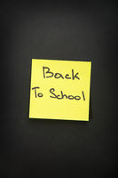 back to school sticker on black