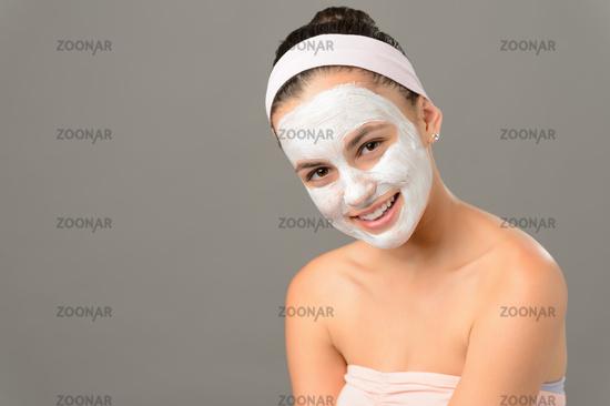 Smiling teenage girl cosmetics mask skin beauty