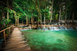 Tropical rain forest jangles with Kuang Si cascade waterfall. Luang Prabang, Laos
