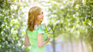 Young girl near the apple tree
