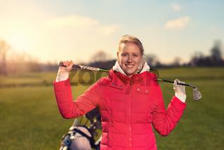 Golfern lächelt in die Kamera