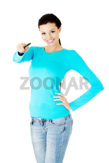 Beautiful casual woman holding pen.