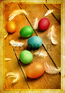 Grunge old carved postcard with eggs to celebrate Easter on the wooden background