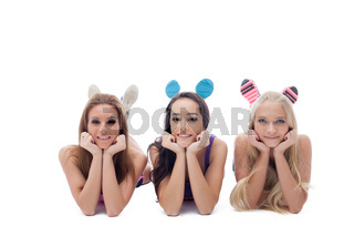 Smiling young female athletes lying in studio
