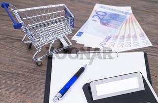 Einkaufswagen Geld und Rechner