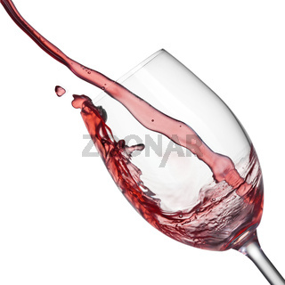 Splash of red wine in wineglass on white