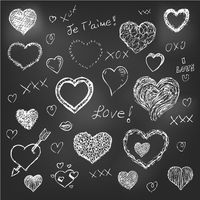 Set of hand drawn hearts on chalkboard background
