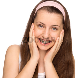 Happy girl with braces isolated
