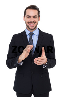 Happy businessman standing and applauding