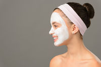 Teenage girl cosmetics mask beauty looking away