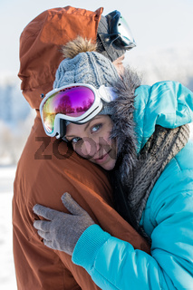 Young couple embracing winter countryside ski snow