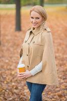 Blond Woman in Fashionable Brown Autumn Attire