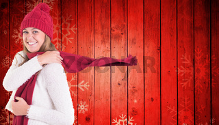 Composite image of happy blonde in winter clothes