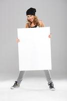 Cool Pretty Woman in Bonnet Holding White Board