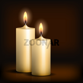 Two burning candles on black background.