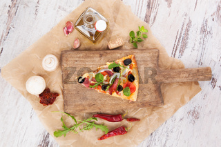 Pizza piece and pizza ingredients.