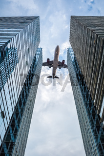 glass skyscrapers with the airplane