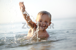 Smiling little boy in the sea