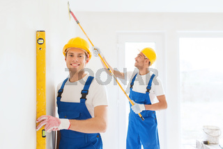 group of builders with tools indoors