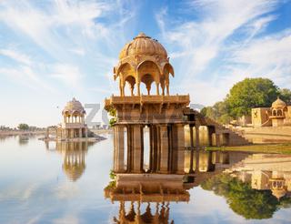 Indian landmarks - Gadi Sagar temple on Gadisar lake -  Jaisalmer, Rajasthan
