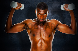 Composite image of determined fit shirtless man lifting dumbbells