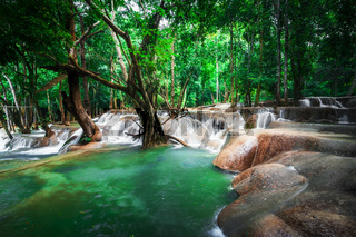 Jangle landscape with turquoise water of Kuang Si waterfall. Laos