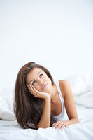Pretty Young Woman Lying in Bed Thinking