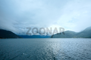 Hardangerfjord summer cloudy view (Norway)