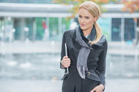 Blond Woman in Fashionable Black Office Attire