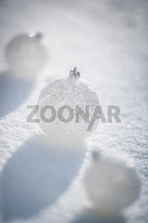 Silver Christmas balls on snow