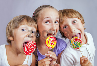 Group children eating candy