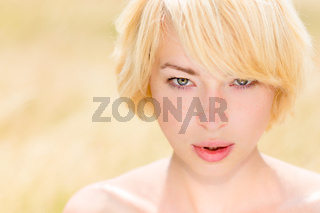 Portrait of beautiful young Caucasian woman outdoor.