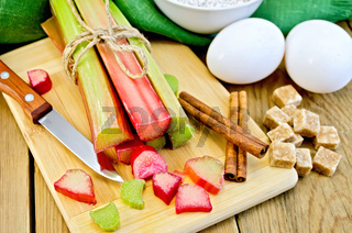 Rhubarb with sugar and eggs on the board