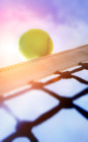 Tennis ball on net´s edge