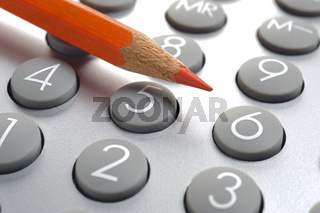 red pencil on financial calculator